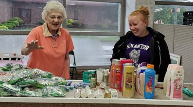 Sister Patricia Fillenwarth, SP and University of Scranton student, Shannon Rattigan work together at the Food Pantry in West Terre Haute.