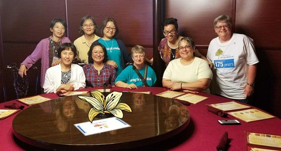 This group of sisters gathered at a restaurant in the evening. From left, standing, Sisters Anji Fan, My Huong Pham, Patty Wallace, Joni Luna. Standing, from left, Sisters Anna Fan, Rosa Pan, Teresa Kang, Dina Bato and Beth Wright.