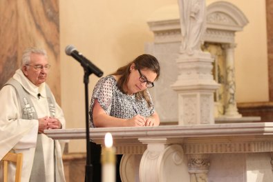 Sister Emily signs her profession papers