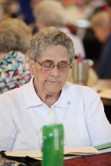 Sister Josephine Paolinelli closes her eyes in prayer during a reflective moment.