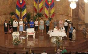 Gathering to distribute communion during Mass.