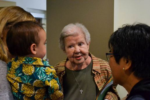 Sister Nancy Nolan greets the grandson of Providence Associate Mel Marino Wolff.