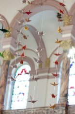 Oragami cranes decorate the church