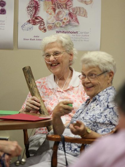 Sisters Patty Fillenwarth and Carol Meyers enjoy a music therapy demonstration.