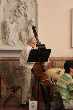Sister Nancy Bartasavich plays the upright bass during the ceremony