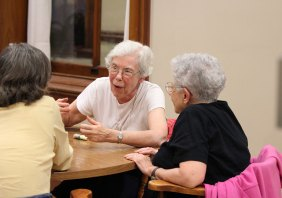 Sister Rosemary Schmalz speaks with sisters during a social time.