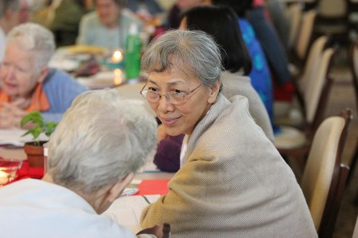 Sister Sophia Chen listens to another sister during table discussion.