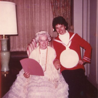 Sister Bernadetta Ryan (sitting) dressed as Martha Washington and Sister Marilyn Baker dressed as a Navy cadet during a July 4 celebration in 1979 at LeFer Hall.