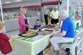 Sister Patty Fillenwarth helps visitors choose between cookies and brownies.