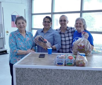 """Breaking bread"" takes on new meaning at the pantry. From left, Sisters Ann Sullivan, Joni Luna, Barb Battista and volunteer Vicki Dickinson."
