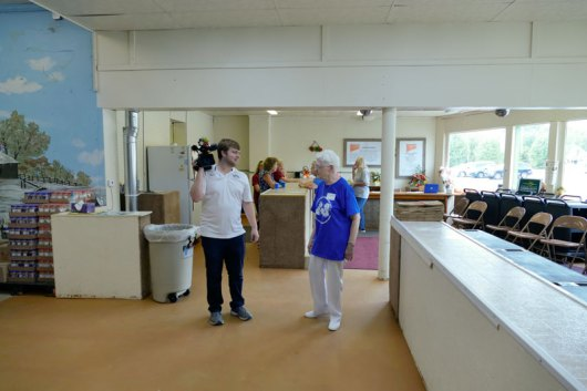 Sister Joseph Fillenwarth, director of the pantry, shows a newsman around.