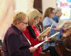Sister Mary Beth Klingel and her candidate companion Bettie Anne Long join in song during the blessing.