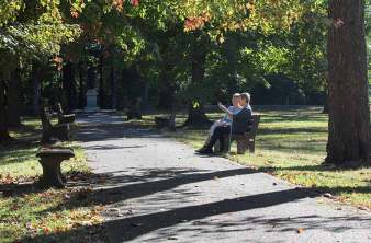 Sister Claire Hanson and candidate Jonnee Western enjoy the fall beauty while deep in discussion