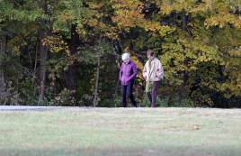 Sister Marsha Speth and her candidate companion Mary Gemma get to know each other during a walk in the Woods.