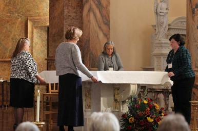 New Providence Associates from front clockwise Jane Moss, Wanda Barney, Karen Maynard and Jan Showalter prepare the altar cloth