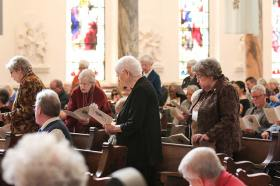 Sisters of Providence and Providence Associate companions rise to present the new Providence Associates