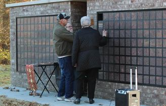 Sister Ann Casper assists Heather's parents as they inter her ashes in the columbarium