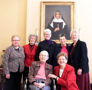 The Sisters of Providence of Saint Mary-of-the-Woods, Indiana, honored their 60-year Jubilarians on Tuesday, Dec. 17, including (front, left) Sister Ellen Cunningham and (back, second from right) Sister Paula Modaff. The two are photographed with (front, right) General Superior Sister Dawn Tomaszewski and (back, from left) General Councilors Sister Mary Beth Klingel, Sister Jeanne Hagelskamp, Sister Lisa Stallings and Sister Jenny Howard. Not photographed: Sisters Clelia Cecchetti, Dorothy Rasche and Therese Guerin Sullivan.