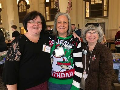 Providence Associate volunteers help run the bake sale. From left, Jan Showalter, Karen Maynard and Linda Dubois.