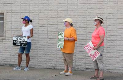 Sisters Jessica, Beth and Barbara join the protesters outside the Terre Haute Police Department