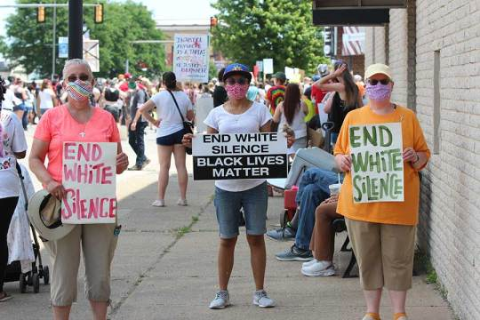 Sisters Barbara Battista, Jessica Vitente and Beth Wright join the peaceful protest