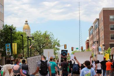 Protesters march back to the courthouse
