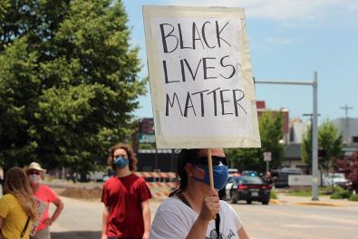 A protester with her Black Lives Matter sign