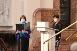 Sisters Janice Smith and Anji Fan offer the intercessions in both English and Mandarin
