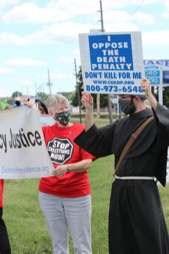Sister Mary Montgomery speaks with Franciscan Brother Ian Bremar during Monday's demonstration