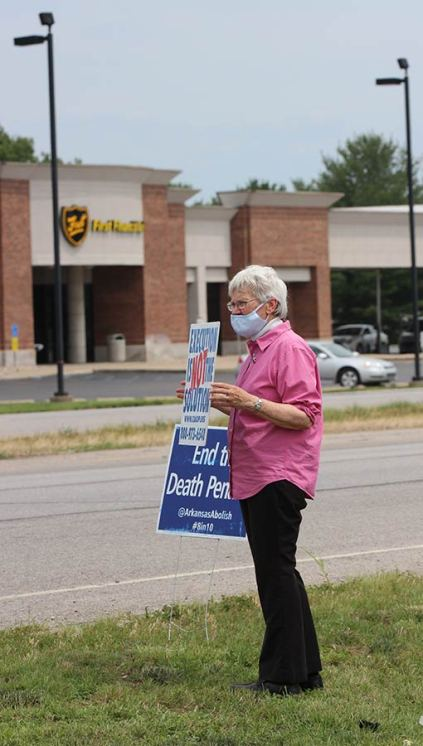 Sister Nancy Bartasavich holds a sign speaking out against the death penalty during Wednesday's protest.