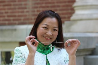 Sister Teresa Kang shows off her new Sisters of Providence cross