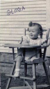 Baby Glory, as Sister Gloria Memering's family called her, sitting in her highchair.