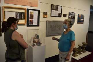 Sister Barbara Bluntzer speaking with someone at the exhibit.