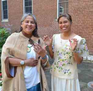 Sister Joni shows off her new ring and Sister Jessica her new cross, both symbols of the vows they have taken, after the ceremony.