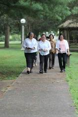 After prayer, Sister Joni and Leslie lead the group in walking to Providence Hall for the entrance ceremony