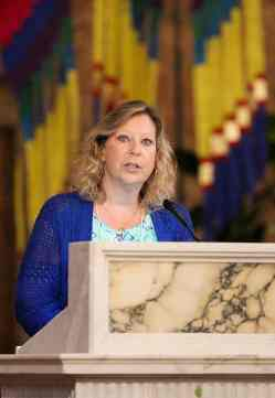 New Providence Associate Tanya Pongracz reads during the Mass.