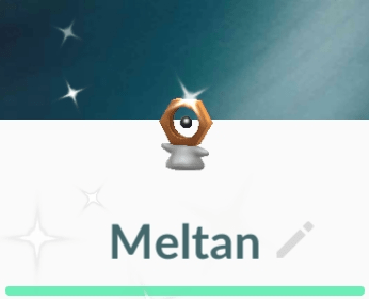 A shiny Meltan. The only difference is a darker body and a blue tail.