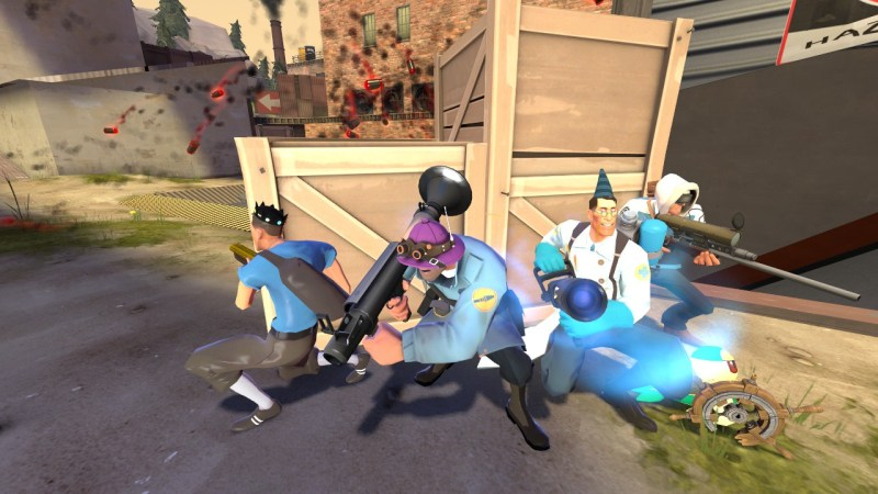 A 4v4 team hiding from a barrage of explosions in TF2
