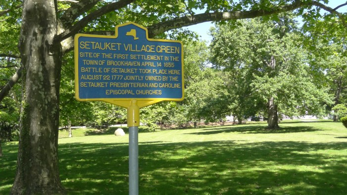 One of New York's iconic blue Historic Markers on the tree-lined Setauket village green.