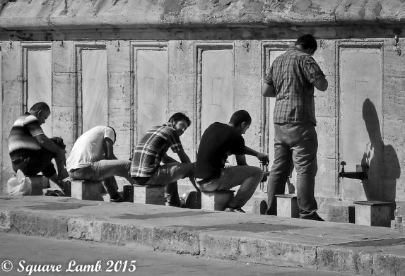 Men washing their feet before entering the mosque