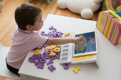 Kid playing with Square Panda learning games