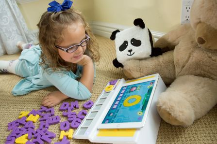 Child playing with Square Panda playset.