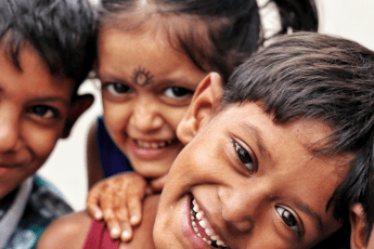 Early learners smiling and holding each other