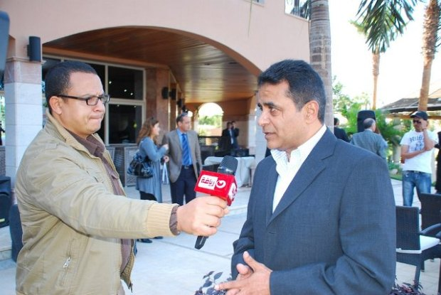 Ashraf Hanafi conducts a TV interview during the Sky Open in New Cairo