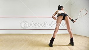 dep_9193231-Sexy-woman-with-tennis-racket-in-squash