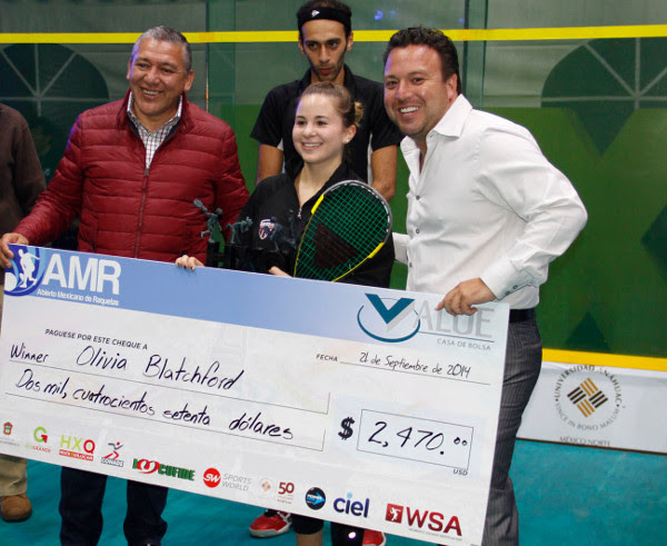 Money shot: Olivia Blatchford collects her giant cheque after winning in Mexico