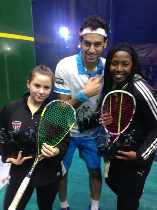 Mohamed Elshorbagy celebrates with women's finalists Olivia Blatchford and Siyoli Waters