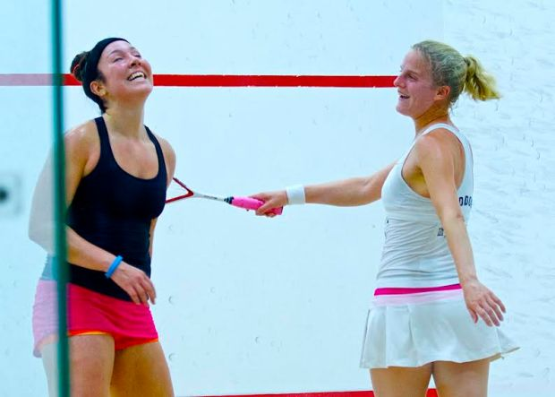 All smiles as Emma Beddoes (right) shares a joke on court with Amanda Sobhy