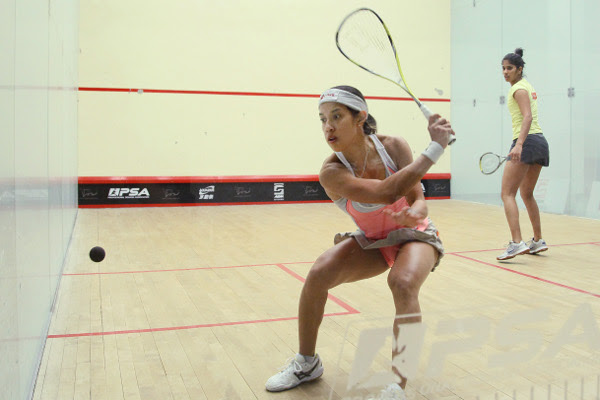 Nicol David chases the ball against Joshna Chinappa