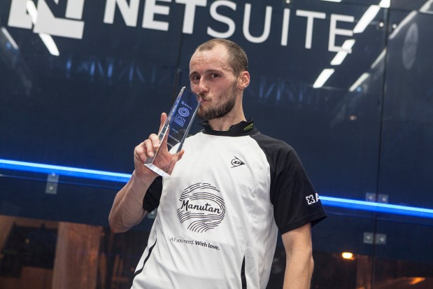 SMILING ASSASSIN: Gregory Gaultier kisses his NetSuite trophy